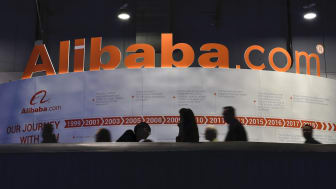 LAS VEGAS, NEVADA - JANUARY 08:Attendees pass by an Alibaba.com display at CES 2019 at the Las Vegas Convention Center on January 8, 2019 in Las Vegas, Nevada. CES, the world's largest annual
