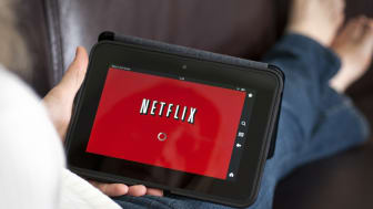 """Alpharetta, GA, USA - September 29, 2012 - Amazon.com's Kindle fire with Netflix's streamable movie page loaded on the tablet."""
