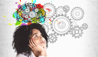A creative thought bubble above a woman's head, including cog wheels.