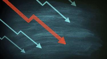Decline in stocks on blackboard