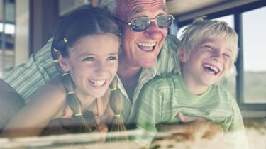 A grandfather enjoys his RV with two of his grandchildren