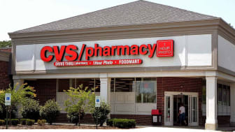 MOUNT PROSPECT, IL - JUNE 23: A woman walks into a CVS store June 23, 2005 in Mount Prospect, Illinois. CVS has introduced their new CVS One-Time-Use Video Camcorder, the world's first single