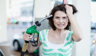 picture of frustrated woman at gas pump
