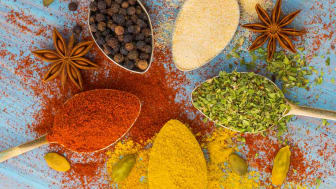 A variety of spices splashed on cutting board