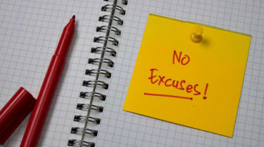 A notebook with a Post-It note that reads No Excuses!
