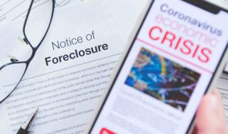 Phone with coronavirus crisis news headline over a foreclosure notice