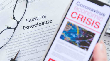 Phone with coronavirus crisis news headline over a foreclosure notice