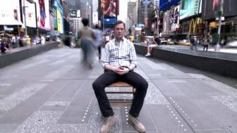 Dan Harris meditating  on a New York street