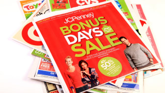 Virginia Beach, Va. USA- November 19, 2013: A studio image of many advertisement flyers for the upcoming Holiday season.Retailers use the advertisements as newspaper fillers to post upcoming