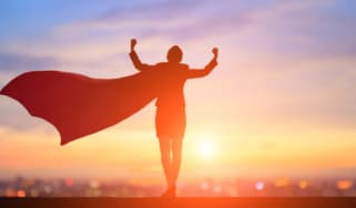 A woman wears a superhero cape that flaps in the wind.