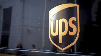 UPS driver walking to home door