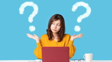 Confused woman with two question marks