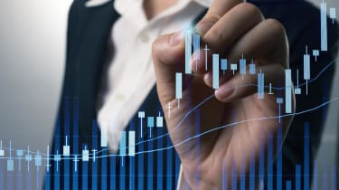 Businessman writing analyze graph for trade stock market on the screen.