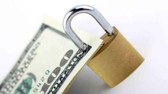 A lock protects a $100 bill