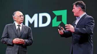 SAN FRANCISCO - OCTOBER 23:Advanced Micro Devices Chairman and CEO Hector Ruiz (L) talks with Dell Chairman of the Board Michael Dell (R) during a keynote address at the 2006 Oracle Open Worl