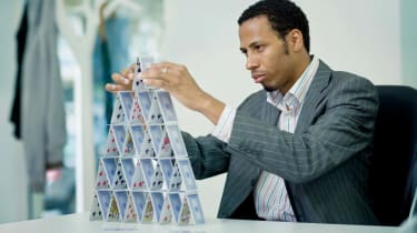 Man building a house of cards