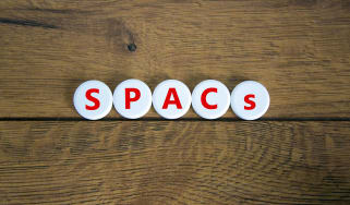 spacs written out with tiles