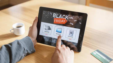 Photo of shopper using iPad for Black Friday sales