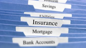 File folders with one labeled insurance.