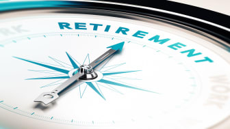 """picture of a compass pointing to the word """"retirement"""""""