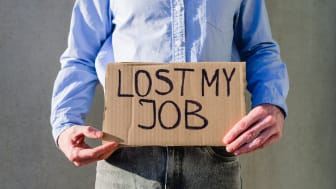 """picture of man holding sign saying """"Lost My Job"""""""
