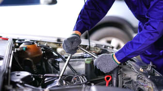 Automotive and car repair shops services by professional engine maintenance technicians. Auto mechanic using Socket wrench repair tools checking car in the Garage