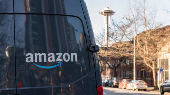 Amazon Prime Now Delivery van on 4th avenue late in the day with Seattle's Space Needle in the background.