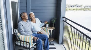 A couple relaxing on their porch