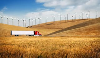 semitruck driving through wheat fields