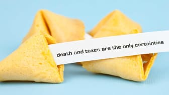 """picture of fortune cookies with a fortune that says """"death and taxes are the only certainties"""""""