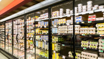 Kitchen staples in glass-enclosed standup grocery cases