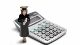 Photo of a college grad figure next to a calculator