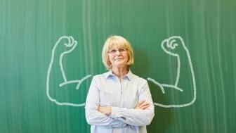 Woman standing at a blackboard