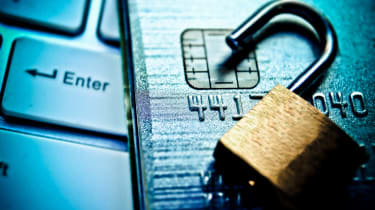 Open security lock on credit cards with computer keyboard / Credit card data breach