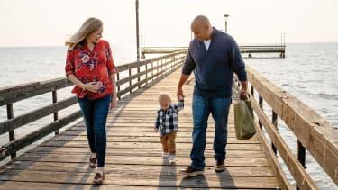 Brain and Marisa Pilarski with son on boardwalk