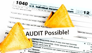 """picture of fortune cookie on a tax form with fortune saying """"Audit possible"""""""