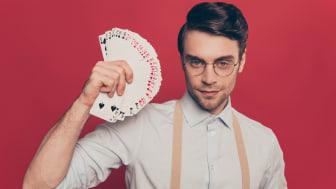 Gambler fanning cards.