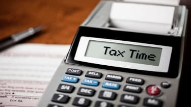 """picture of calculator with """"tax time"""" displayed on the screen"""
