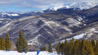 Downhill skiers on the winter mountain slopes in Vail, Colorado