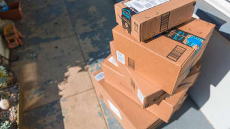Los Angeles CA, November 11/22/2017: Image of an Amazon packages. Amazon is an online company and is the largest retailer in the world. Cardboard package delivery at front door during the hol
