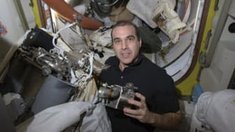 FILE - In this April 14, 2014 photo provided by NASA, astronaut Rick Mastracchio works to replace a pump in a spacesuit aboard the International Space Station. Mastracchio, a University of Co
