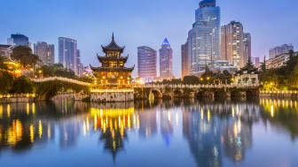 Cityscape of Guiyang at night, Jiaxiu Pavilion on the Nanming River. Located in Guiyang City, Guizhou Province, China.