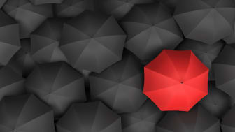3d rendering of open bright red umbrella towering over an endless amount of similar black umbrellas. Unique outlook. Bright idea. Different opinion.