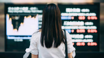 A woman looks at stock performance charts.