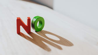 """picture of two block letters spelling """"no"""" on a table"""