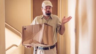 Messenger delivering a heavily damaged parcel