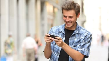 Man playing game with a smart phone