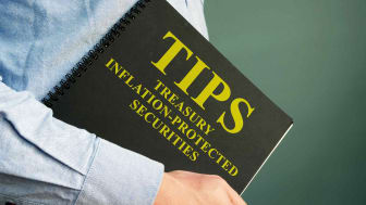 A man holding a book about Treasury Inflation-Protected Securities