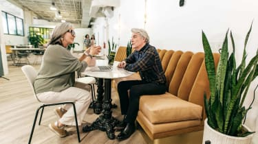 Senior couple having a conversation while dining out