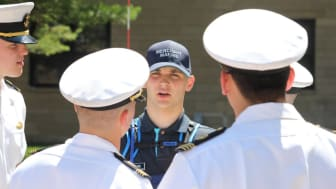 picture of upperclassmen giving instructions to an underclassman at the Merchant Marine Academy